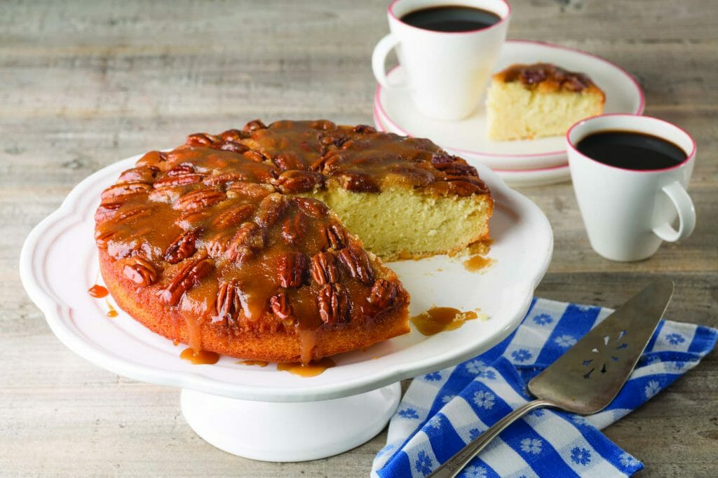 Pecan Upside Down Cake On Cake Stand With Coffee