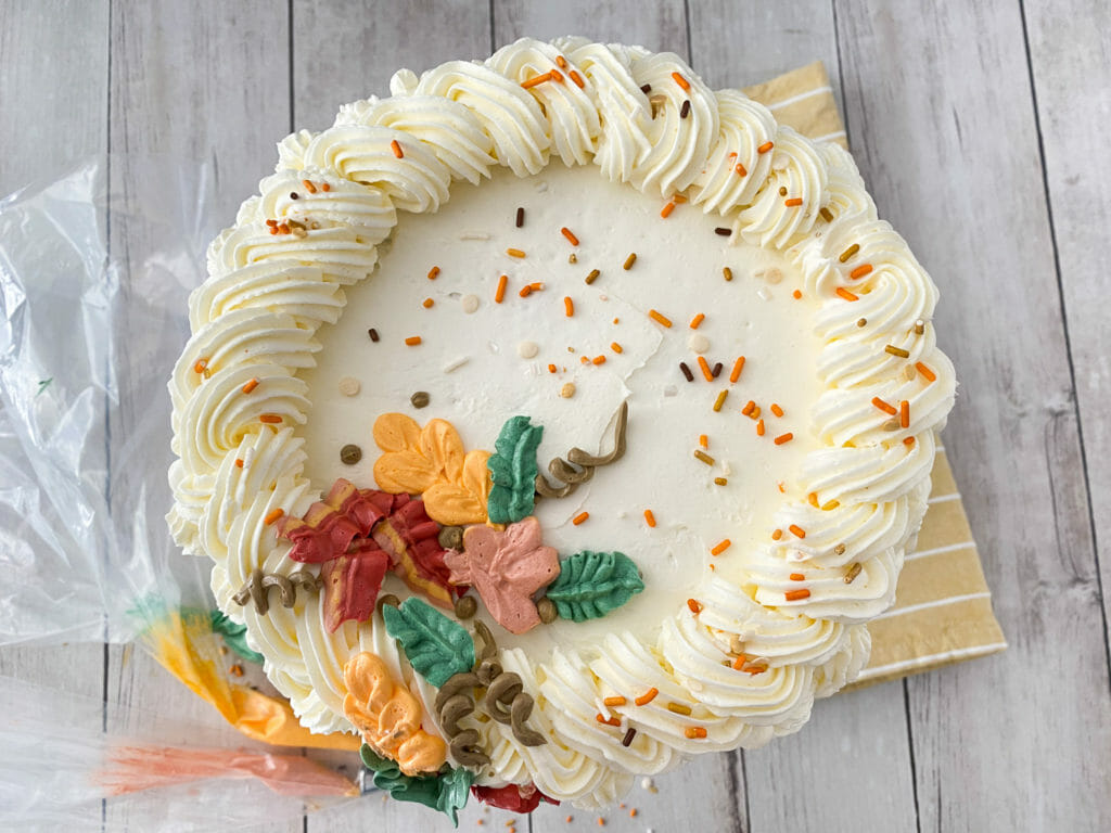 Vanilla-Frosted Cake With Fall Leaves